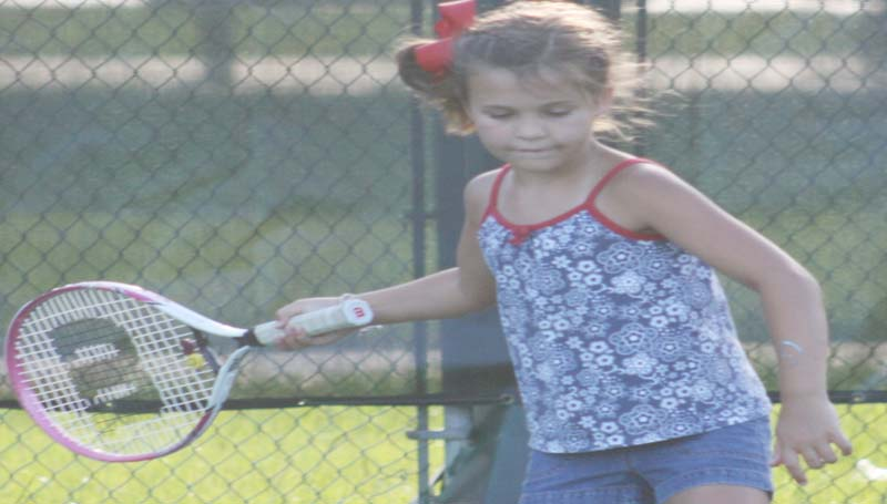 DAILY LEADER / MARTY ALBRIGHT / Aby Locke prepares to return the serve during a junior tennis drill at the Brookhaven City Courts.