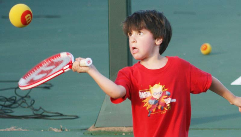 DAILY LEADER / MARTY ALBRIGHT / Brooklyn Lee hustles in for the serve during a pre-junior tennis drill at the Brookhaven City Courts. During the month of June, the Brookhaven Tennis Association is providing Junior Team tennis lessons for kids 10 and under at the Brookhaven City Courts on Tuesday and Thursday nights from 6 to 7 p.m.