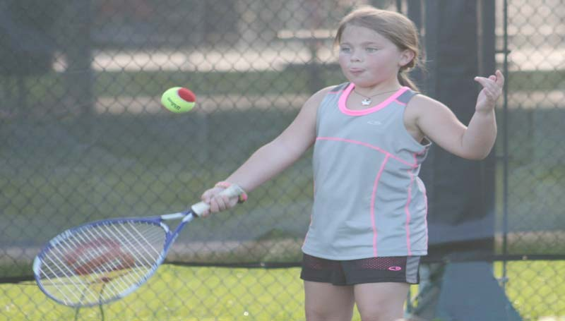DAILY LEADER / MARTY ALBRIGHT / Lily Lambert prepares to hit the ball during a junior tennis drill at the Brookhaven City Courts.