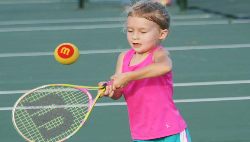 DAILY LEADER / MARTY ALBRIGHT / Miriam Calcote prepares to hit the ball during a pre-junior tennis drill at the Brookhaven City Courts.