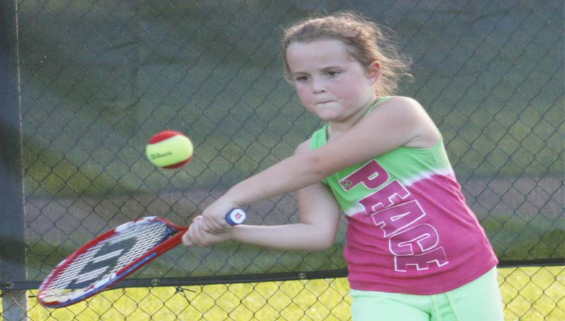 DAILY LEADER / MARTY ALBRIGHT / Mylane Newman practices her swing during a Junior Tennis drill at the Brookhaven City Courts.