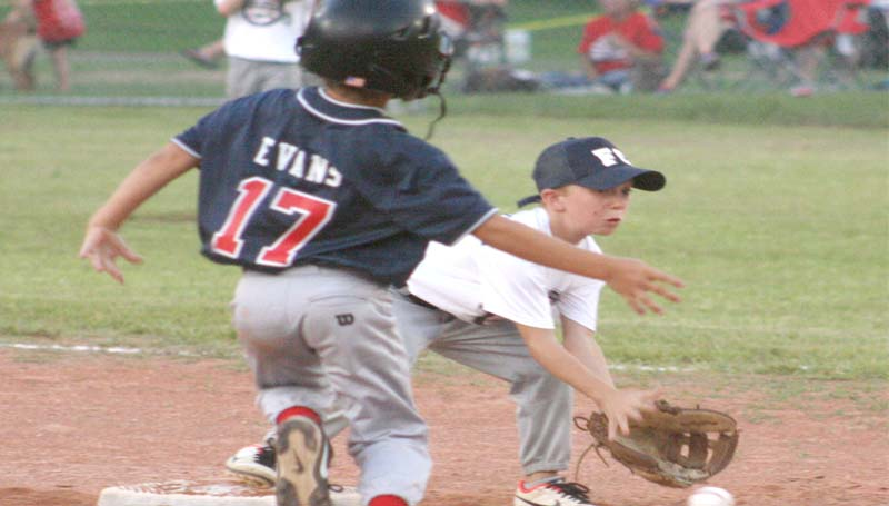 DAILY LEADER / MARTY ALBRIGHT / Franklin County All-Stars' shortstop Landon Furlow (right) records the out at second base as Lincoln County Nationals' Samuel Evans prepares to slide in AA Coach-Pitch eight-year-old All-Star game Friday night.