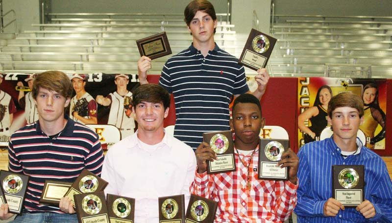DAILY LEADER / MARTY ALBRIGHT / The Enterprise Boys basketball team was honored during the school's athletic banquet. Players receiving awards were (seated, from left) Forrest Scott, Most Valuable Offensive, All-Lincoln, All-District; John Gray, Most Valuable Player, Best Free Throw Shooter, All-Lincoln, All-District; Dwayne Pendleton, Most Valuable Defensive, All-District; Zach Hodges, Most Improved; (Standing) Dylan Furr, Coaches Award.