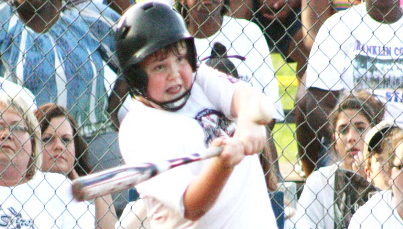 DAILY LEADER / MARTY ALBRIGHT / Noah McCormick provides a big hit for his Franklin County All-Star team Tuesday night against the Lincoln County Nationals.