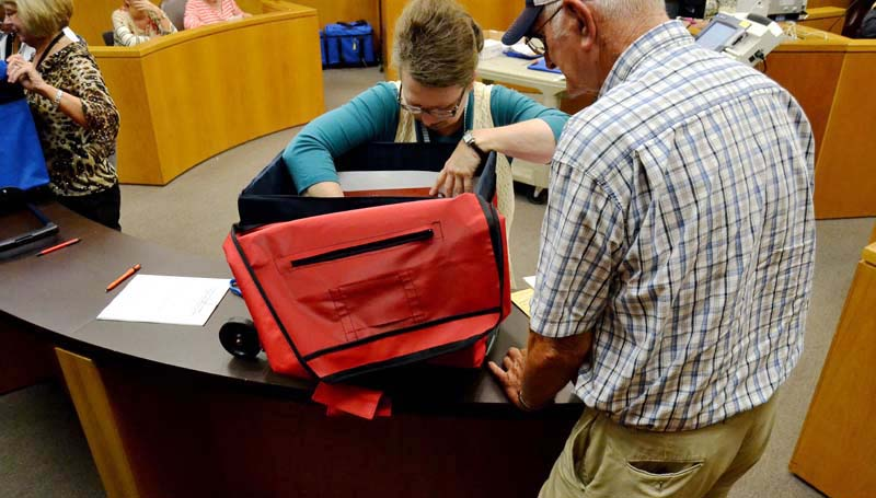 DAILY LEADER / RACHEL EIDE / Keasha Dickerson with the Lincoln County circuit clerk's office receives Little Byhalia voting results from Alfred Smith Tuesday night.