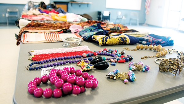 The folding tabletop shows the array of items, including clothes, purses and jewelry waiting for people to take home.