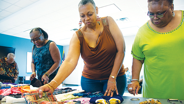 Flora Scott, ( from left) Katheleen Crump, Gloria Ashley and Celestine Spriggs sort through donations looking for items to take home.