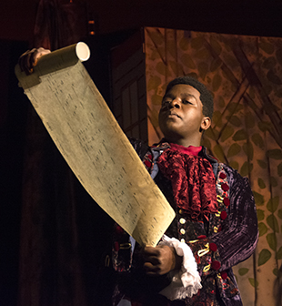 The herald, played by Austin Showers reads the Prince's proclamation at dress rehearsal Thursday.