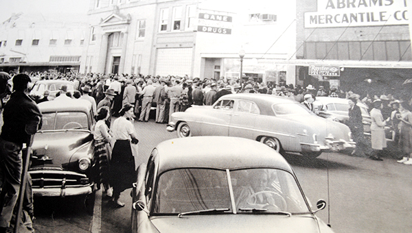PHOTO SUBMITTED / A crowd is gathered in front of Bane Drugs grand opening at the business's original location on Whitworth Avenue in 1954.