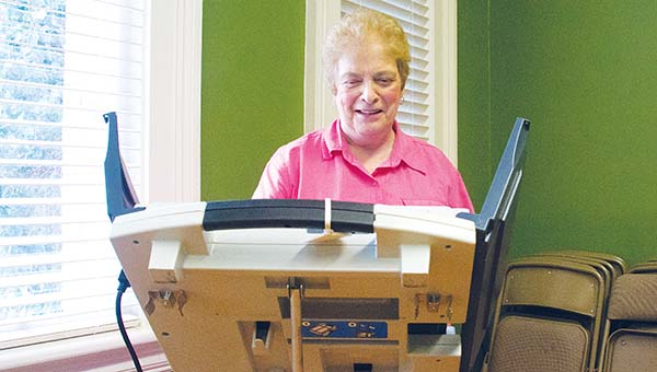 DAILY LEADER / KATIE WILLIAMSON / Montiel Beeson casts her ballot in the Republican Senate primary runoff election at the Brookhaven-Lincoln County Chamber of Commerce polling place Tuesday.