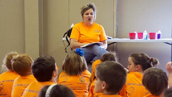 Millie Porter, founder of the Reading Nook, reads to a group of campers at the Reading Extravaganza.