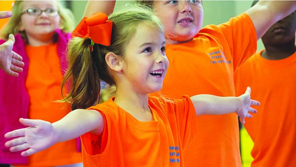 "DAILY LEADER / KATIE WILLIAMSON / Addison Waltman, 5, laughs during a game of ""Simon Says"" during the Reading Extravaganza Friday."