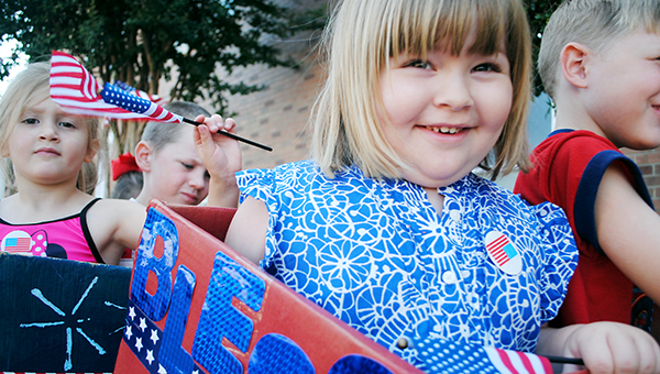 DAILY LEADER / JULIA V. PENDLEY / CELEBRATING AMERICA - First Baptist Church Wee Care students participate in an Independence Day parade around downtown Wednesday. The Fourth of July parade went from the church east to State Bank and around the block. Among those participating are (front) Maddie Mayes; (back, from left) Camryn Poole and Kadyn Bowman.