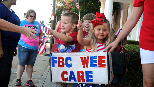 Participating in the parade are (front, from left) Hayden Caples, Gracie Fitzsimmons and (back) Cohen Leggett.