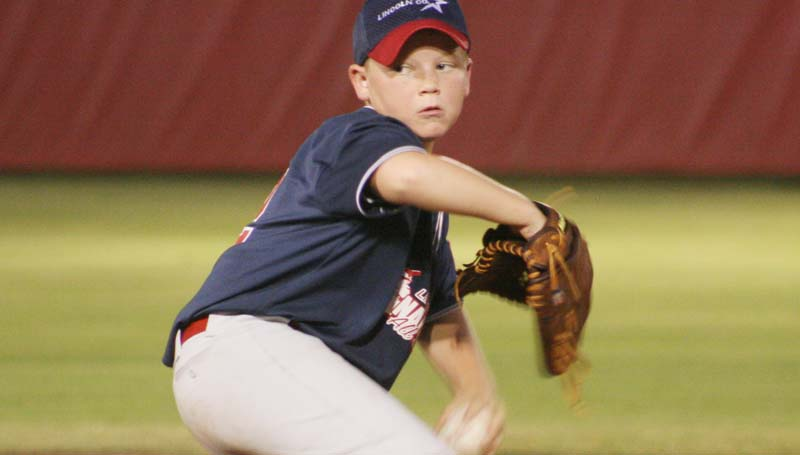 DAILY LEADER / MARTY ALBRIGHT / Lincoln County Nationals pitcher Dawson Hester prepared to deliver his pitch to Natchez Monday's nightcap action in Dixie Youth AAA action.
