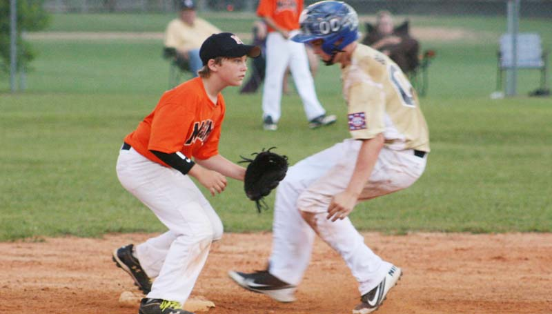 DAILY LEADER / MARTY ALBRIGHT / Franklin County's runner Trevor Bolyer reaches second base safely on a passed ball as McComb shortstop Brandon Roberts works to make a play Thursday night.