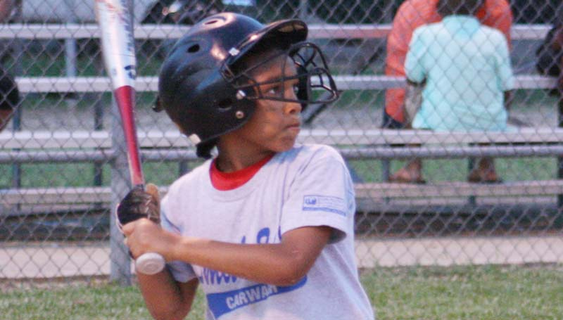 DAILY LEADER / MARTY ALBRIGHT / Caleb Jett looks ready to hit the ball hard for his Smith 84E Carwash team Friday night.