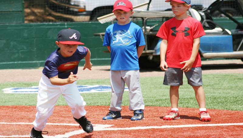 """DAILY LEADER / MARTY ALBRIGHT / John Butler Smith (left) leads off a drill during Nook Logan's NL7 """"Catch, Throw, Hit and Run"""" clinic. The three-day camp was held for kids who wished to improve their baseball skills. The kids participating in the clinic said that they had a lot of fun."""