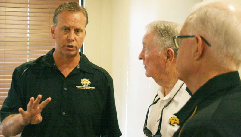 DAILY LEADER / MARTY ALBRIGHT / Southern Miss head football coach Todd Monken socializes with a couple Southern Miss Alums Don Driskell (center) and Bobby Britt (right) during a USM Southwest Central Mississippi Alumni Chapter meeting Monday night at Mitchell's Restaurant.