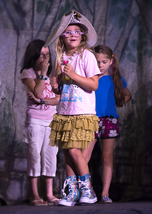 DAILY LEADER / KATIE WILLIAMSON / Evelyn Waterloo, almost 8, plays with her fairy wings (atop her head) Wednesday during practice for Brookhaven Little Theater's children's' production of Sleeping Beauty. The play will be presented today and Friday.