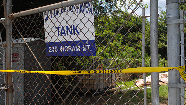 DAILY LEADER / LYNDY BERRYHILL / Yellow security tape was stretched across the entrance gate to the Ingram Street water tower Wednesday after an accident earlier in the day left a construction worker dead.
