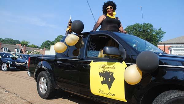 Mary Graham, class of 1970, brings back the style of the 70s during the Alexander High School reunion parade this weekend.