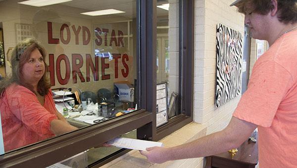 DAILY LEADER / KATIE WILLIAMSON / Jordan Bullock, 16 receives a school schedule Tuesday from the Loyd Star High School secretary, Della Douglas.
