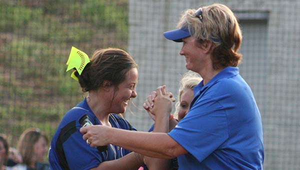 DAILY LEADER / MARTY ALBRIGHT / Brookhaven Academy first-year head coach Becky Flowers (right) receives congratulations from her players after the win.
