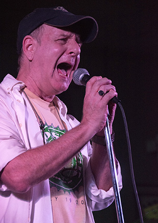 DAILY LEADER / KATIE WILLIAMSON / Don Jacobs sings with the Brutes in the Brookstock Music Festival in the Brookhaven Recreation Center Saturday. He is the founder of the Festival and has released a new album Drive.