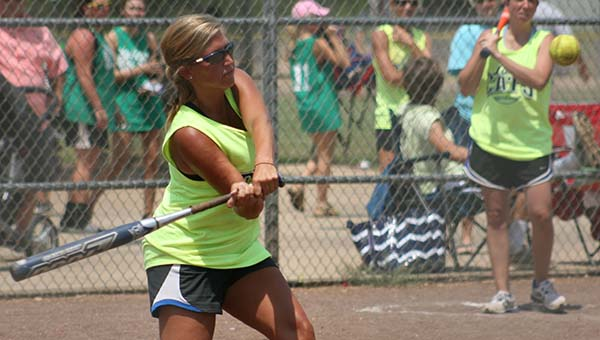 Candace Avants collects a hit for her Bogue Chitto Alumni softball team Saturday.