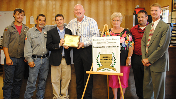 DAILY LEADER / LYNDY BERRYHILL / Loomis International Inc. received the Brookhaven-Lincoln County Chamber of Commerce July Business of the Month Award. Pictured are (from left) Adam Anglin, Pete Tatum, Garrick Combs, Larry Johnson, Wanza McGuffie, Jacob Pellegrim and Dustin Walker.