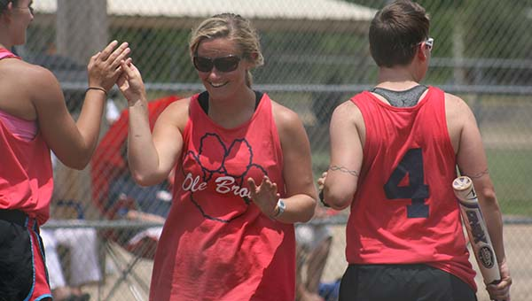 DAILY LEADER / MARTY ALBRIGHT / Ole Brook Alumni Sabrina Smith is congratulated at home plate by her teammates Katie Stewart (left) and Teri Hodges after hitting a home run Saturday in the First Annual Lady Panthers Area Alumni Tournament at Hansel King Sportsplex.